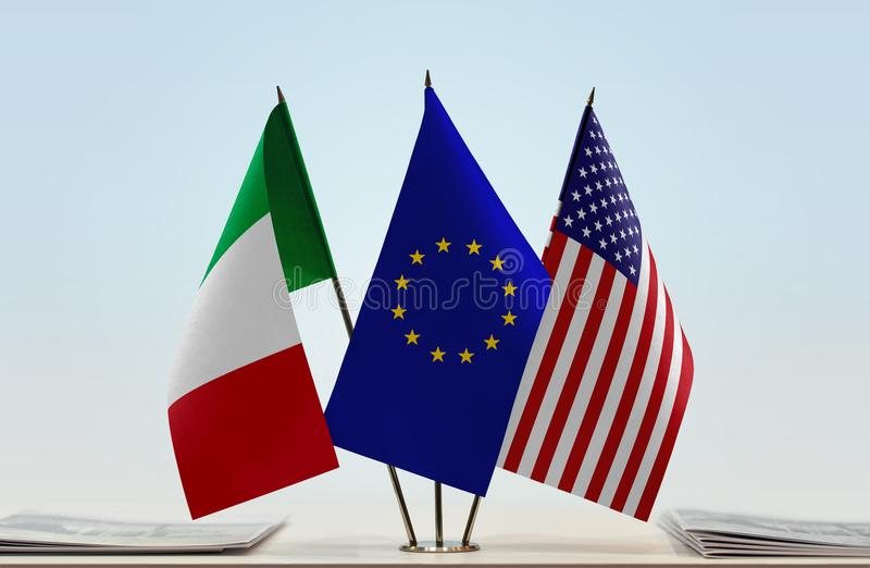 Flags of Italy EU and USA. Desktop flags of Italy and USA with European Union flag in the middle stock photography