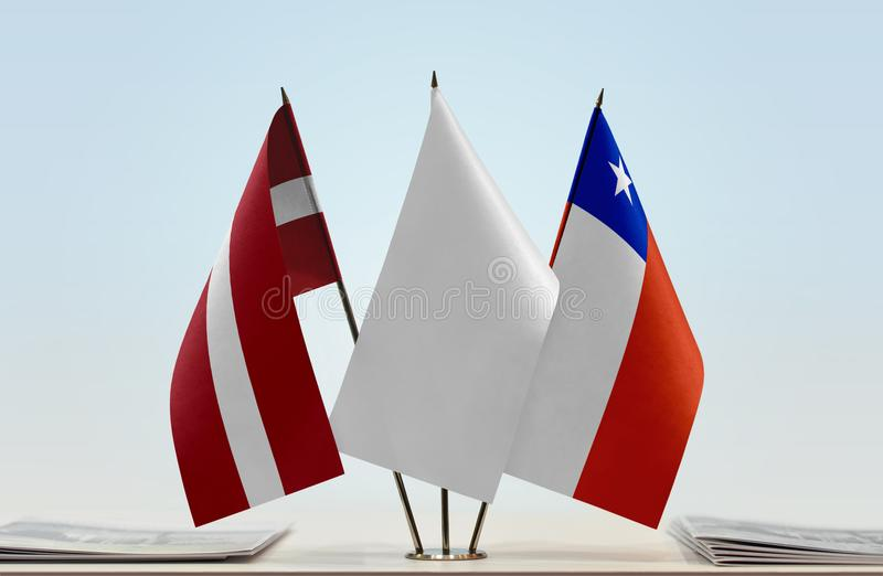 Flags of Latvia and Chile. Desktop flags of Latvia and Chile with white flag in the middle royalty free stock images