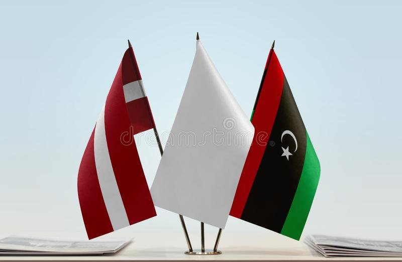 Flags of Latvia and Libya. Desktop flags of Latvia and Libya with white flag in the middle stock illustration