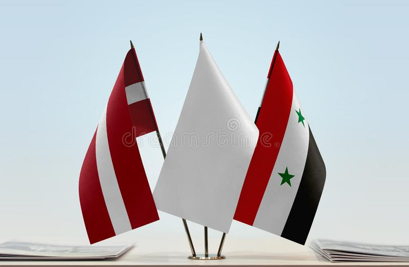 Flags of Latvia and Syria. Desktop flags of Latvia and Syria with white flag in the middle stock illustration