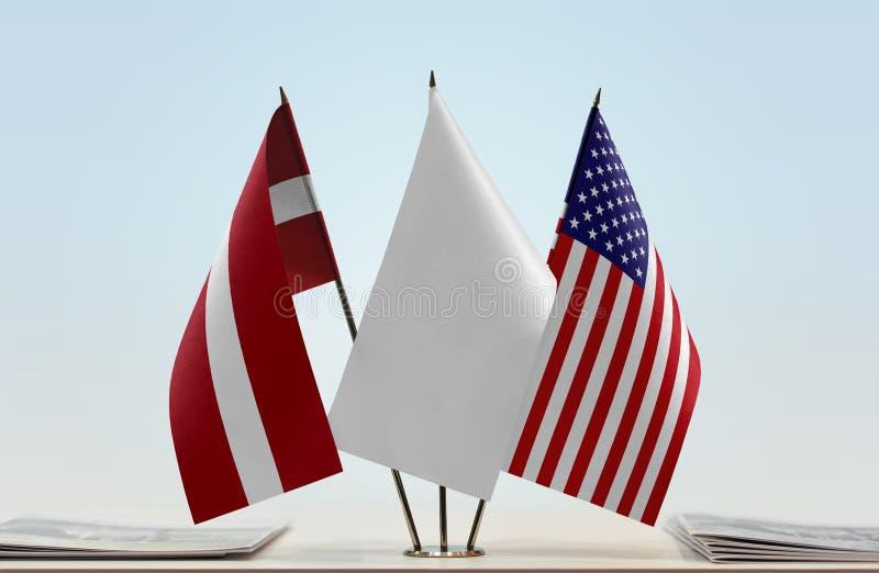 Flags of Latvia and USA stock photography