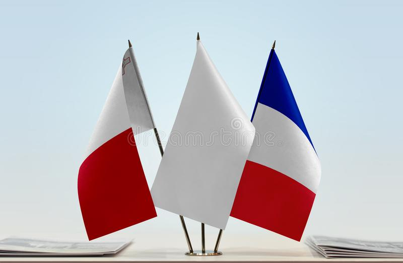 Flags of Malta and France. Desktop flags of Malta and France with a white flag in the middle stock photos