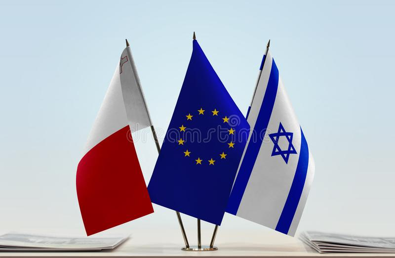 Flags of Malta EU and Israel. Desktop flags of Malta and Israel with European Union flag in the middle royalty free stock images
