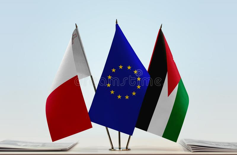 Flags of Malta EU and Jordan. Desktop flags of Malta and Jordan with European Union flag in the middle royalty free stock photos