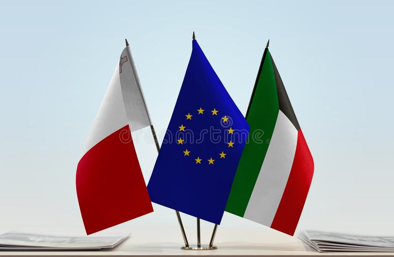 Flags of Malta EU and Kuwait. Desktop flags of Malta and Kuwait with European Union flag in the middle royalty free stock photos
