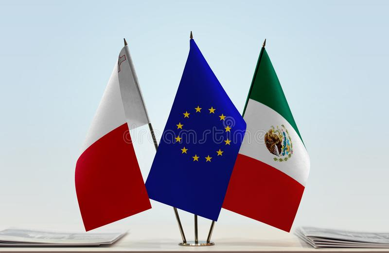 Flags of Malta EU and Mexico. Desktop flags of Malta and Mexico with European Union flag in the middle royalty free stock image