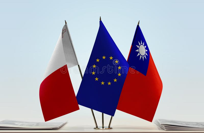 Flags of Malta EU and Taiwan. Desktop flags of Malta and Taiwan with European Union flag in the middle stock image