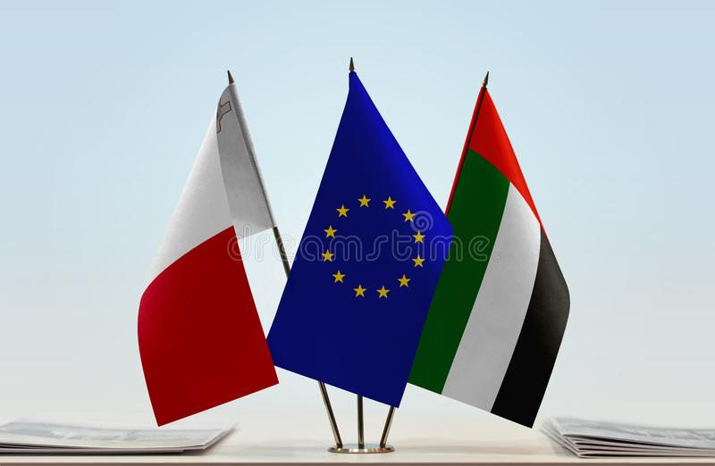 Flags of Malta EU and UAE. Desktop flags of Malta and UAE with European Union flag in the middle stock photos