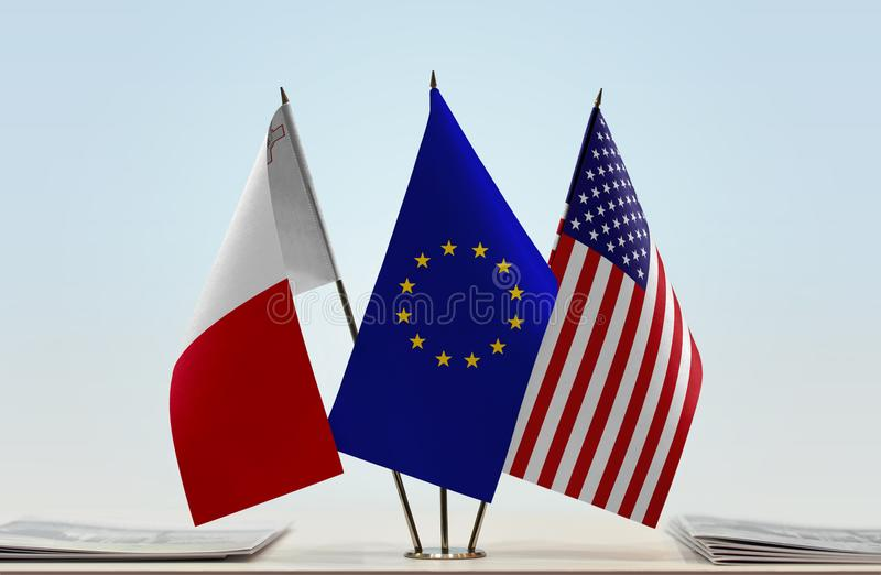 Flags of Malta EU and USA. Desktop flags of Malta and USA with European Union flag in the middle stock image