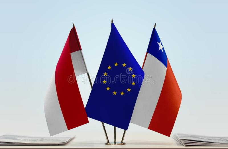 Flags of Monaco EU and Chile. Desktop flags of Monaco and Chile with European Union flag in the middle royalty free stock images
