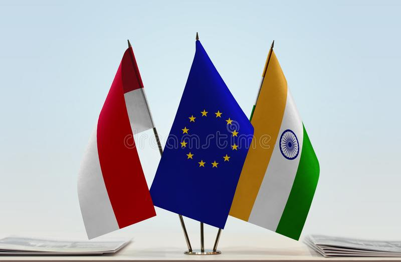 Flags of Monaco EU and India. Desktop flags of Monaco and India with European Union flag in the middle royalty free stock photography