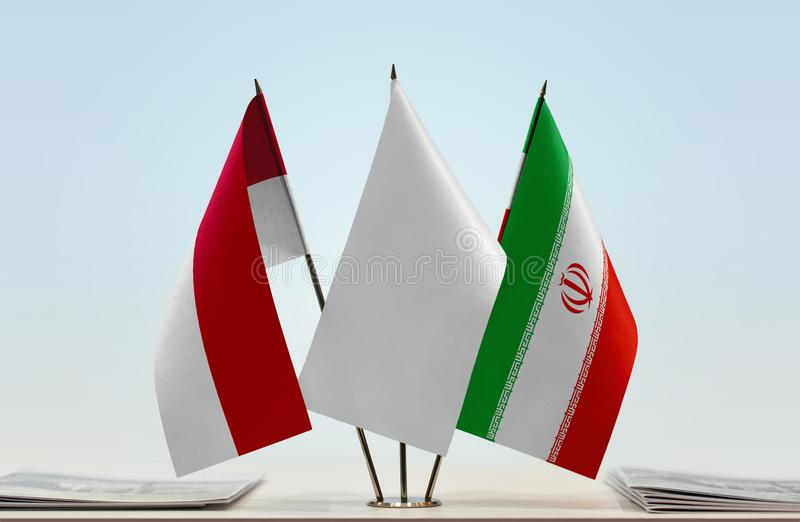 Flags of Monaco and Iran. Desktop flags of Monaco and Iran with white flag in the middle royalty free stock images
