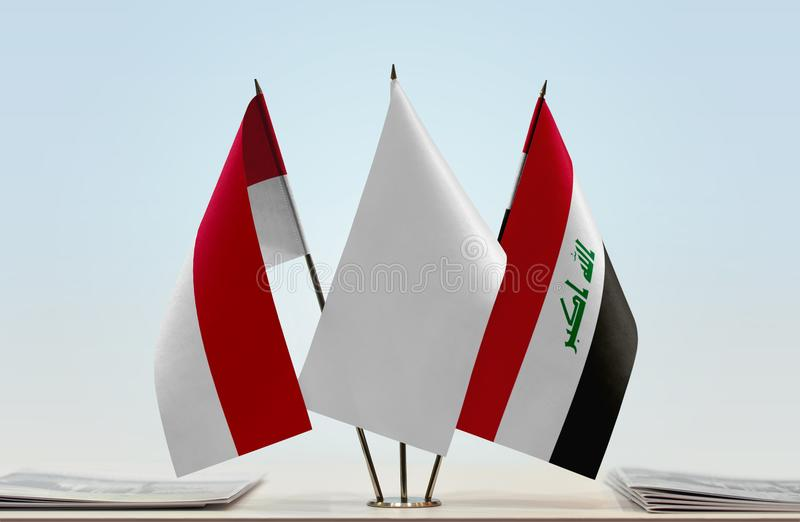 Flags of Monaco and Iraq. Desktop flags of Monaco and Iraq with white flag in the middle stock images