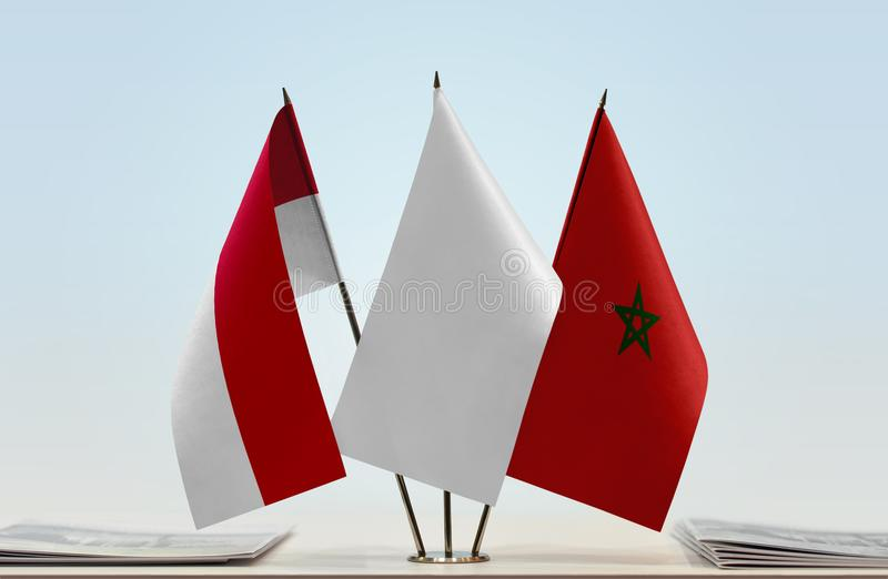 Flags of Monaco and Morocco. Desktop flags of Monaco and Morocco with white flag in the middle stock photo