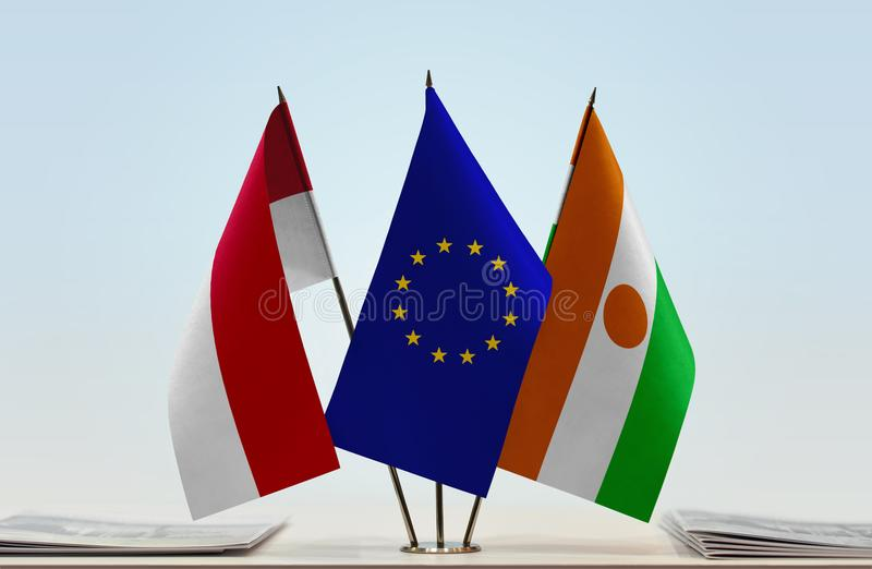 Flags of Monaco EU and Niger. Desktop flags of Monaco and Niger with European Union flag in the middle royalty free stock images