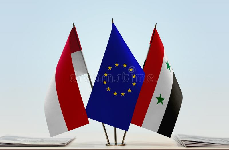 Flags of Monaco EU and Syria. Desktop flags of Monaco and Syria with European Union flag in the middle royalty free stock photography
