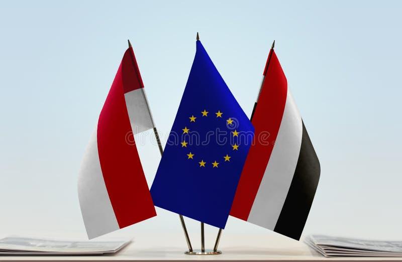 Flags of Monaco EU and Yemen. Desktop flags of Monaco and Yemen with European Union flag in the middle stock photo