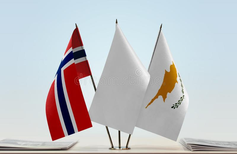 Flags of Norway and Cyprus. Desktop flags of Norway and Cyprus with a white flag in the middle royalty free stock images