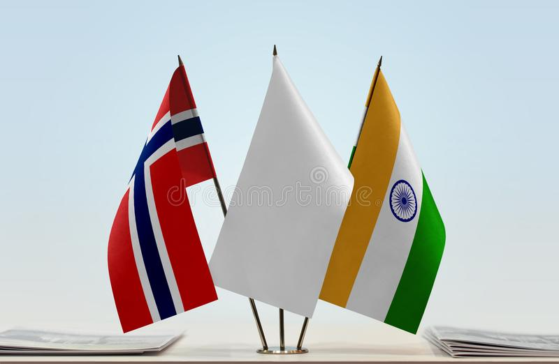 Flags of Norway and India. Desktop flags of Norway and India with white flag in the middle stock photography