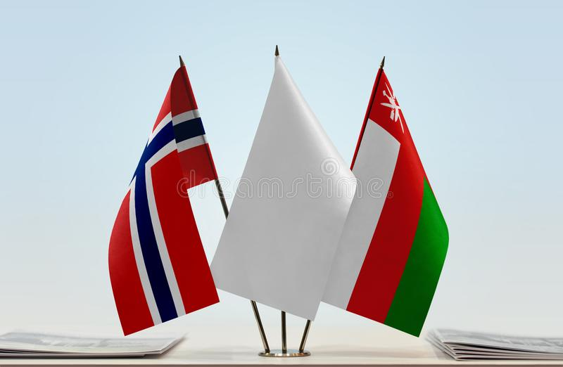 Flags of Norway and Oman. Desktop flags of Norway and Oman with white flag in the middle stock photo