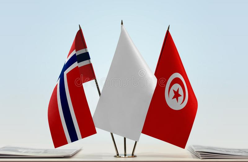 Flags of Norway and Tunisia. Desktop flags of Norway and Tunisia with white flag in the middle royalty free stock photography