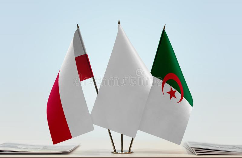 Flags of Poland and Algeria. Desktop flags of Poland and Algeria with white flag in the middle royalty free stock photo