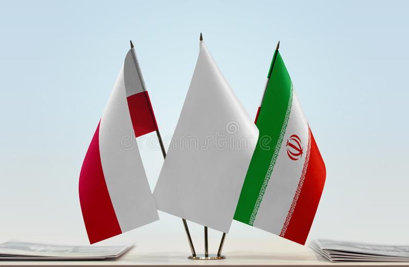 Flags of Poland and Iran. Desktop flags of Poland and Iran with white flag between royalty free stock photography