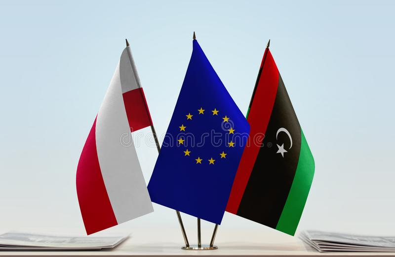 Flags of Poland EU and Libya. Desktop flags of Poland and Libya with European Union flag in the middle vector illustration