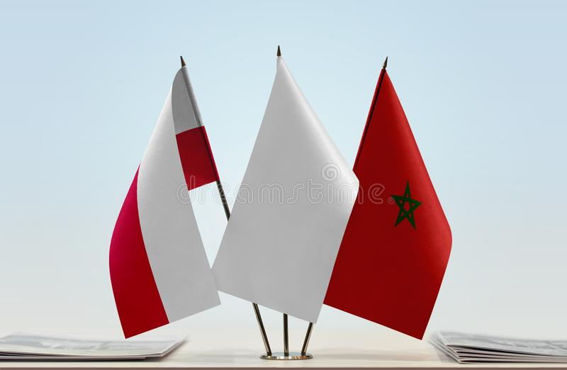 Flags of Poland and Morocco. Desktop flags of Poland and Morocco with white flag between royalty free stock photos