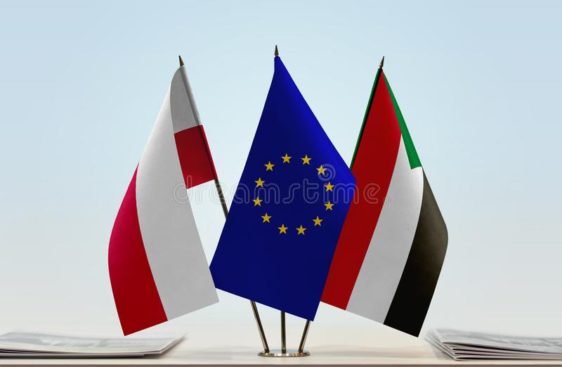 Flags of Poland EU and Sudan. Desktop flags of Poland and Sudan with European Union flag in the middle royalty free illustration