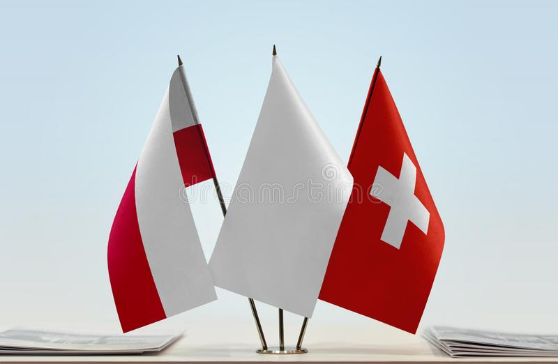 Flags of Poland and Switzerland. Desktop flags of Poland and Switzerland with a white flag in the middle stock images