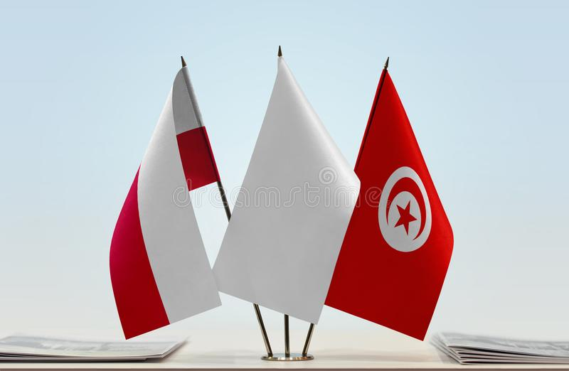 Flags of Poland and Tunisia. Desktop flags of Poland and Tunisia with white flag between royalty free stock photo