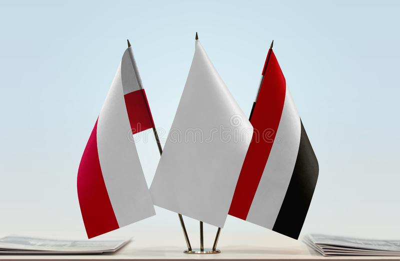 Flags of Poland and Yemen. Desktop flags of Poland and Yemen with white flag in the middle stock images