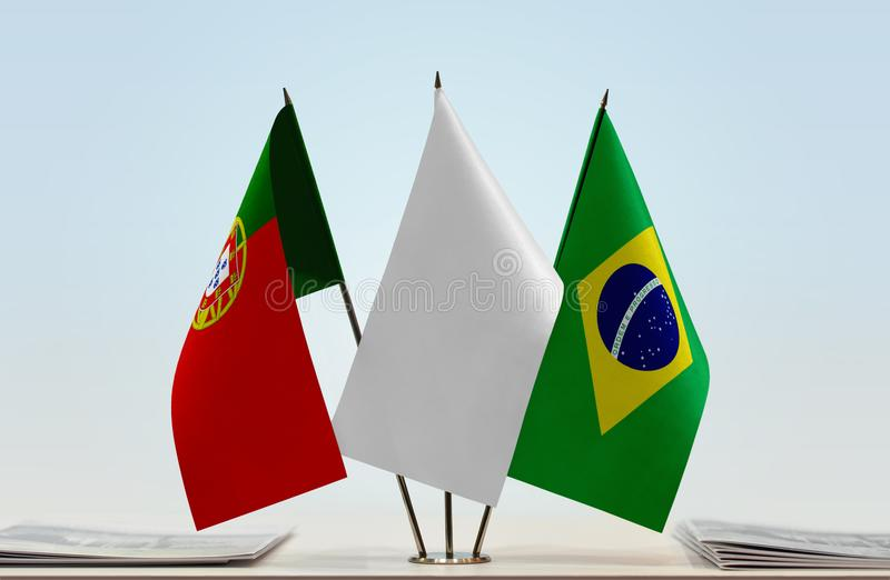 Flags of Portugal and Brazil. Desktop flags of Portugal and Brazil with white flag between royalty free stock images