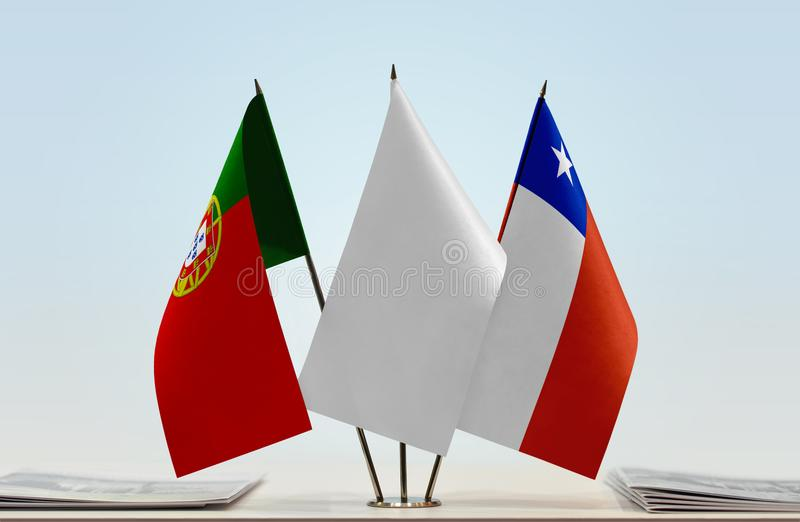 Flags of Portugal and Chile. Desktop flags of Portugal and Chile with white flag between royalty free stock images