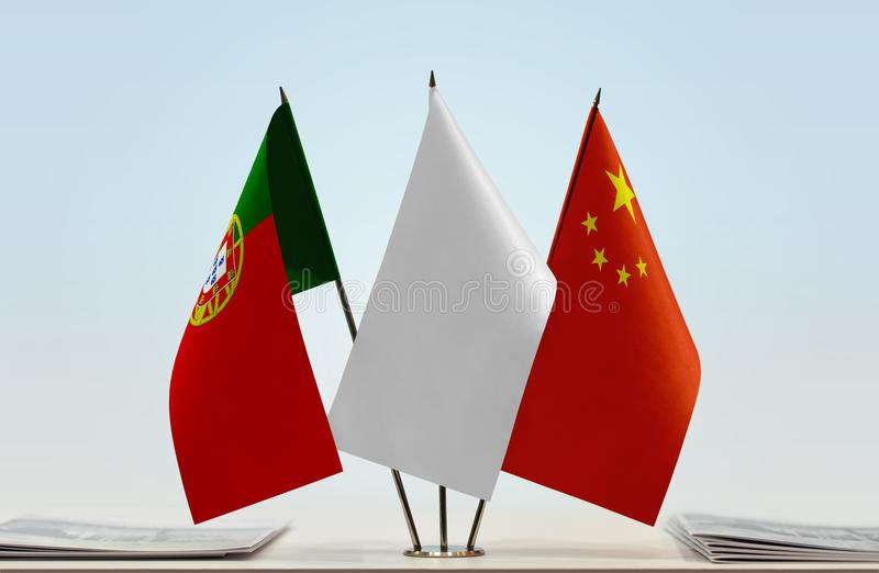 Flags of Portugal and China. Desktop flags of Portugal and China with white flag between stock images