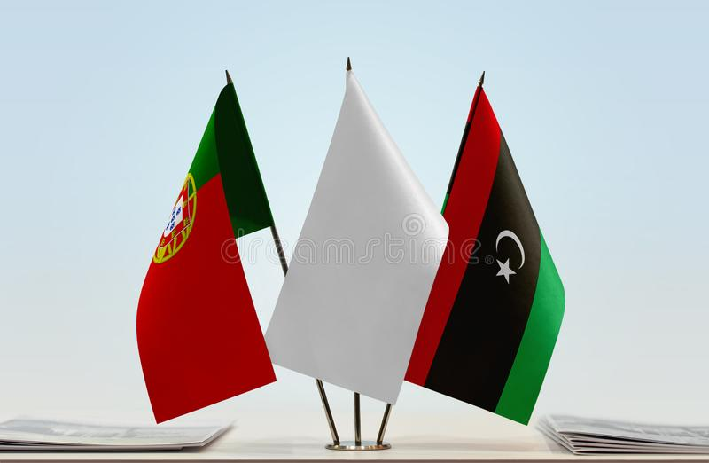 Flags of Portugal and Libya. Desktop flags of Portugal and Libya with white flag between royalty free stock image