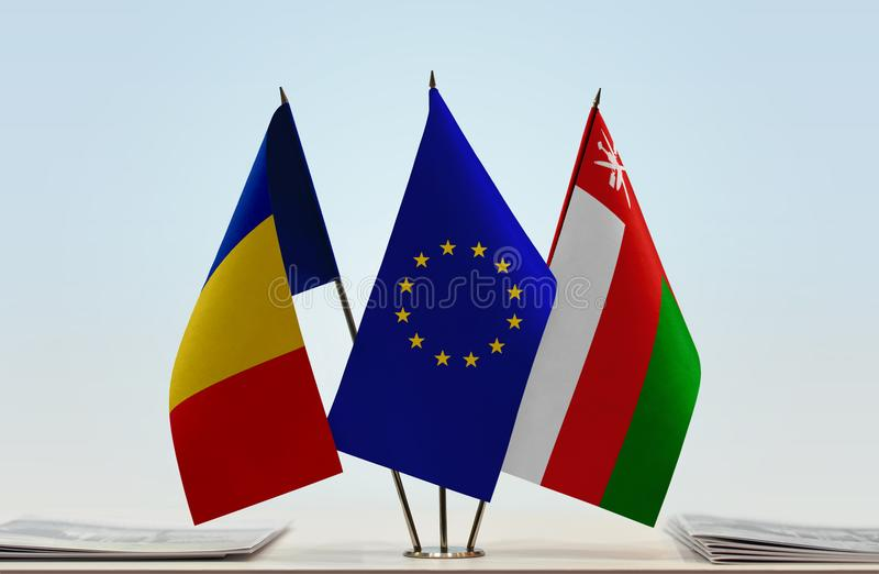 Flags of Romania EU and Oman. Desktop flags of Romania and Oman with European Union flag in the middle vector illustration
