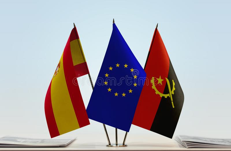 Flags of Spain EU and Angola. Desktop flags of Spain and Angola with European Union flag in the middle royalty free illustration