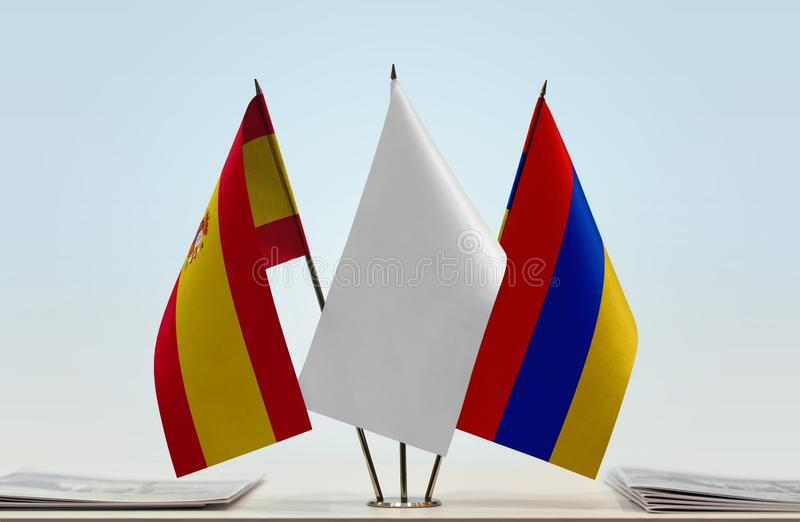 Flags of Spain and Armenia. Desktop flags of Spain and Armenia with a white flag in the middle stock illustration