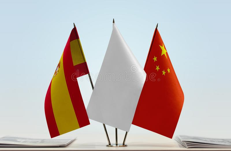 Flags of Spain and China. Desktop flags of Spain and China with white flag between royalty free stock images