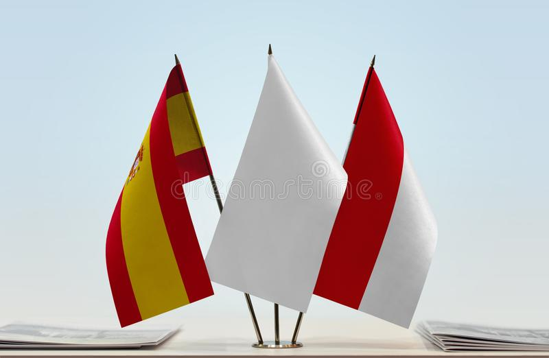 Flags of Spain and Monaco. Desktop flags of Spain and Monaco with a white flag in the middle vector illustration