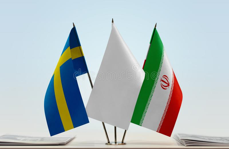 Flags of Sweden and Iran. Desktop flags of Sweden and Iran with white flag between stock photo