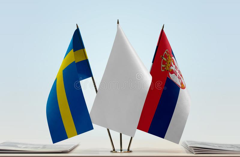 Flags of Sweden and Serbia. Desktop flags of Sweden and Serbia with a white flag in the middle royalty free stock photography