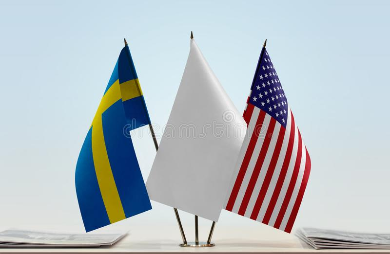 Flags of Sweden and USA stock image