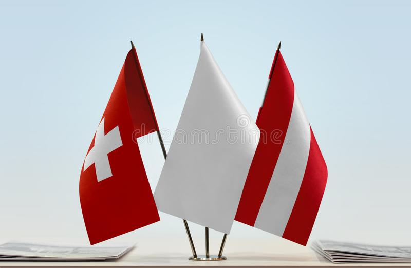 Flags of Switzerland and Austria. Desktop flags of Switzerland and Austria with a white flag in the middle stock images