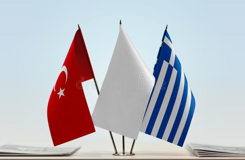 Flags of Turkey and Greece. Desktop flags of Turkey and Greece with a white flag in the middle royalty free stock photo