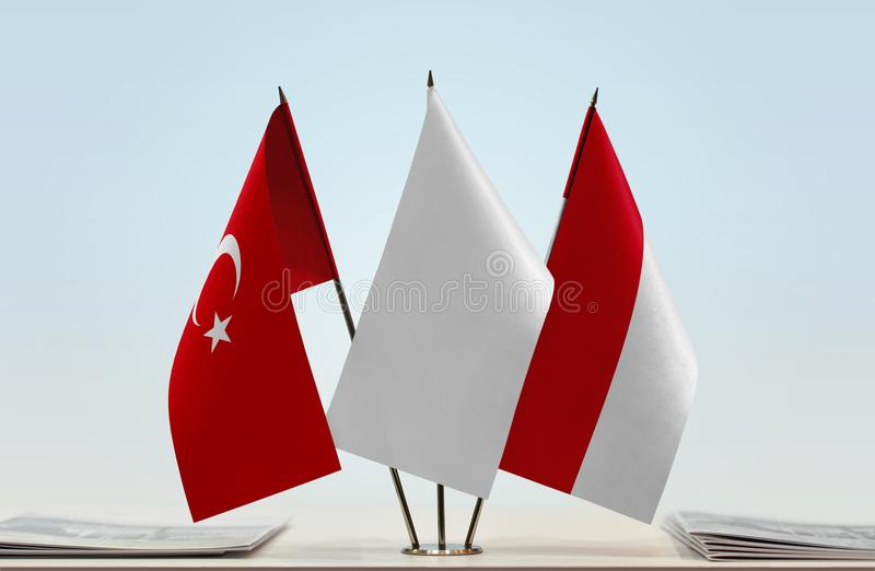 Flags of Turkey and Monaco. Desktop flags of Turkey and Monaco with a white flag in the middle royalty free stock photo
