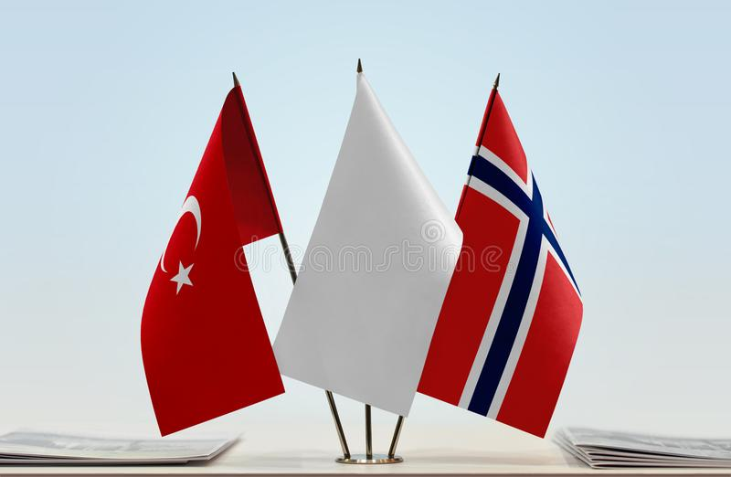Flags of Turkey and Norway. Desktop flags of Turkey and Norway with a white flag in the middle stock photos