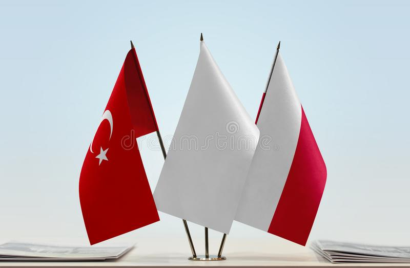 Flags of Turkey and Poland. Desktop flags of Turkey and Poland with a white flag in the middle stock photo